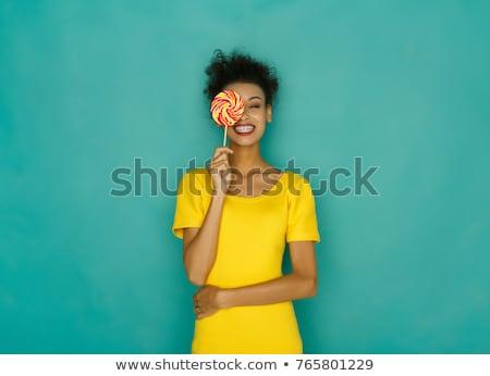 Glimlachende vrouw lolly portret glimlachend brunette oog Stockfoto © julenochek