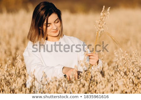 Young girl holds up ears of corn Stock photo © IS2