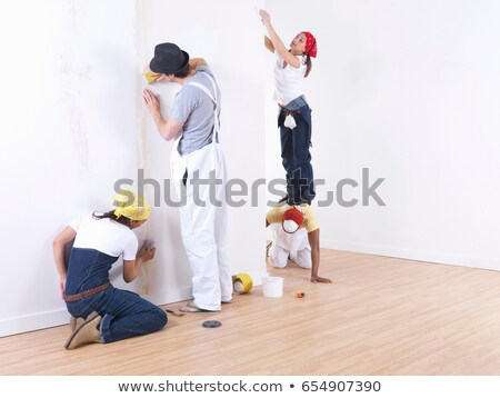 Group of friends sanding wall. Stock photo © IS2