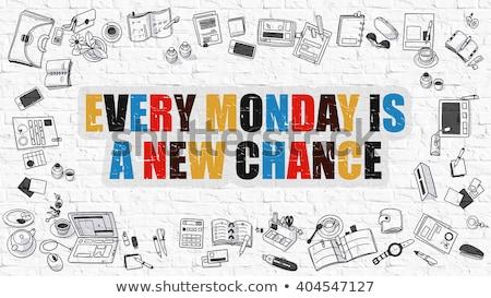 every monday is a new chance on white brick wall stock photo © tashatuvango