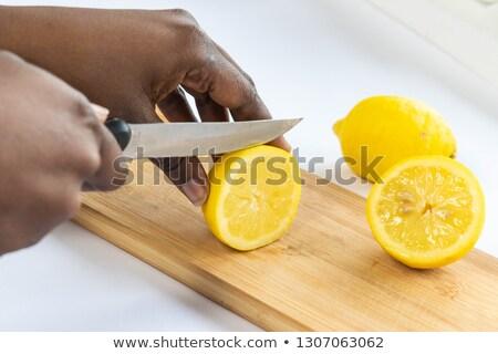 woman cutting lemons for lemonade Stock photo © IS2
