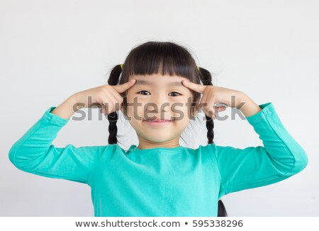 Asia nino senalando ceja feliz sonriendo Foto stock © szefei