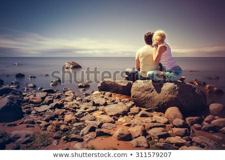カップル · 座って · ビーチ · 笑みを浮かべて · 男 · 冬 - ストックフォト © is2