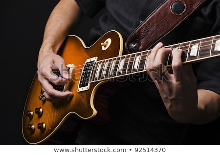 Um guitarra elétrica jogador diversão comunicação em pé Foto stock © IS2