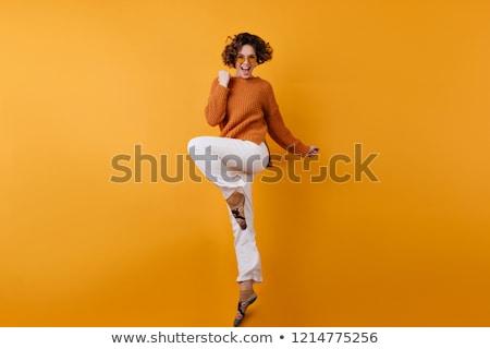 Photo élégante jolie femme cheveux bouclés robe Photo stock © deandrobot
