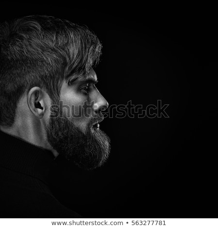 Portrait of a puzzled young casual man stock photo © deandrobot