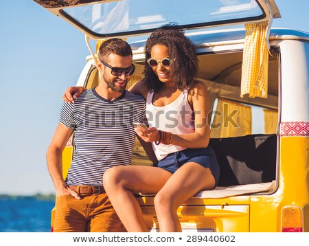 Photo of cheerful hippie people men and women, smiling while wal Stock photo © deandrobot