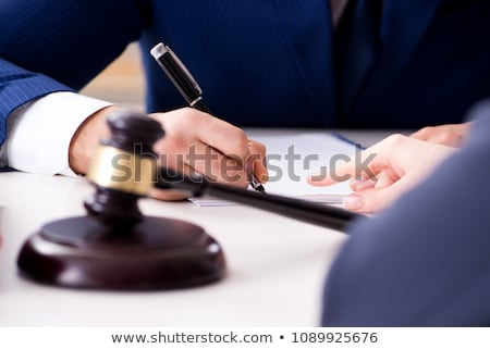judge explaining document to his client stock photo © andreypopov