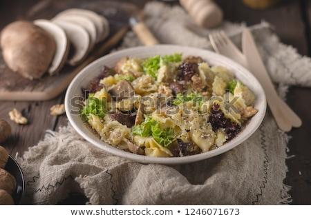 homemade tortellini with mushrooms and walnuts stock photo © peteer