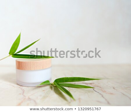 face cream with bamboo leaves over light background stock photo © dashapetrenko