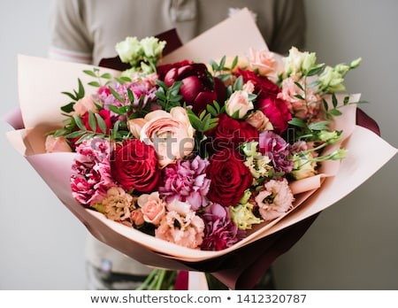 hands of woman florist holding beautiful bouquet of peonies stock photo © illia