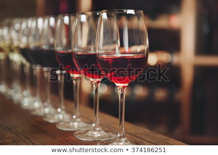 Glasses of red wine in a row on a table  Stock photo © amok
