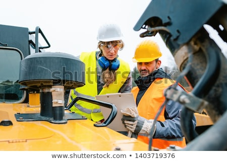 Workers in open-cast mining operation pit Stock photo © Kzenon