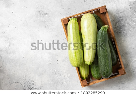 Fresh green zucchini on wooden rustic table. Stock photo © marylooo