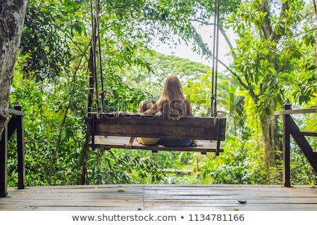 Mamma figlio swing tropicali giardino uomo Foto d'archivio © galitskaya