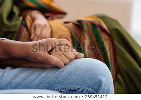 Hands of supportive mature husband holding those of his wife Stock photo © pressmaster