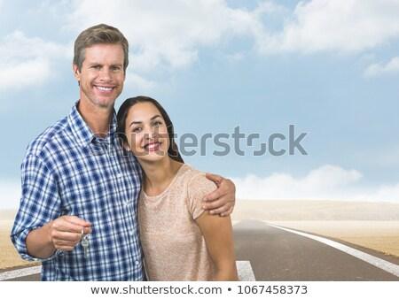 Couple  Holding key in front of road Stock photo © wavebreak_media