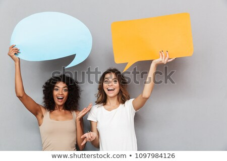 couple texting with empty chat bubbles stock photo © wavebreak_media