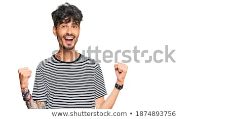 Cheerful, proud attractive young hispanic man with tattoo arm, clench fists and yelling upbeat, achi Stock photo © benzoix
