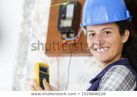 Electrician using a voltmeter Stock photo © photography33