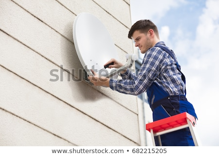 satellite dishes on a wall stock photo © taigi