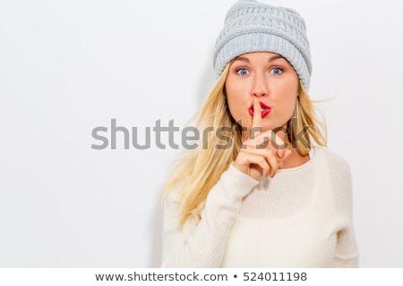happy woman with finger on lips Stock photo © dolgachov