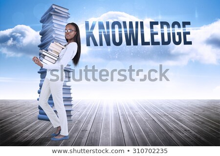 Side view of smiling woman carrying a stack of books against a white background Stock photo © wavebreak_media