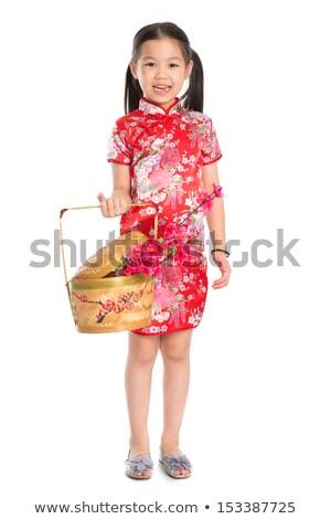 Chinese girl holding a gift basket Stock photo © szefei