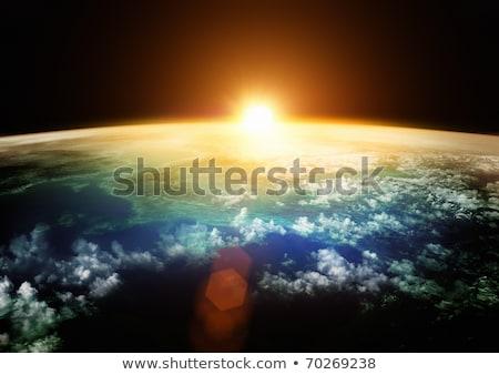 Aarde spectaculaire zonsondergang universum hemel wereldbol Stockfoto © Discovod