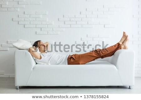 brunette lies on brown sofa Stock photo © ssuaphoto