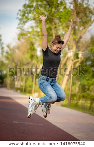 cheerful young women on roller skates outdoor stock photo © candyboxphoto