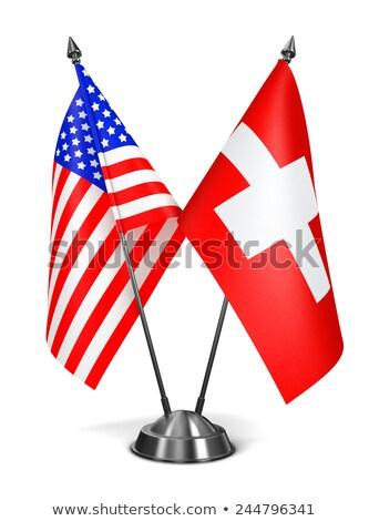 EUA Suíça miniatura bandeiras isolado branco Foto stock © tashatuvango
