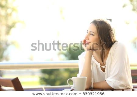 Portret femeie şedinţei balcon fată Imagine de stoc © deandrobot