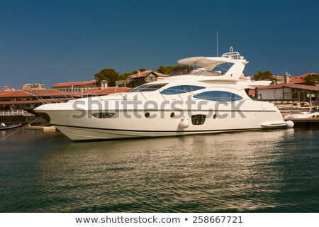 Row of luxury motorised yachts moored in a sheltered harbour stock photo © sarymsakov