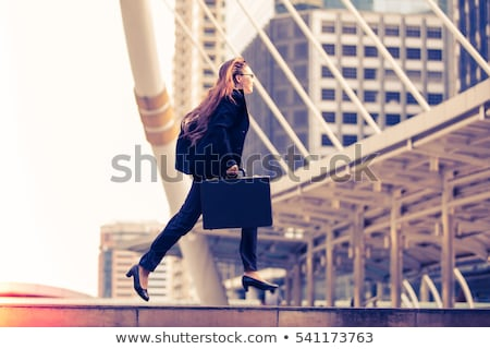 Business Woman with briefcase Stock photo © piedmontphoto