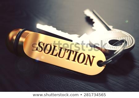 Answer - Bunch of Keys with Text on Golden Keychain. Stock photo © tashatuvango