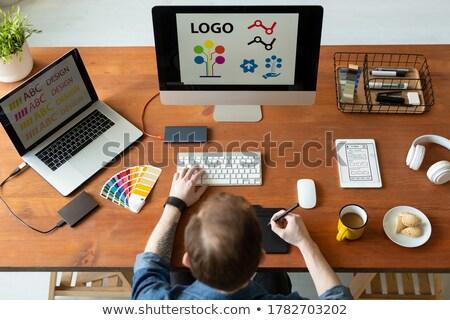 Businessman viewing e-mail on digital tablet computer Stock photo © stevanovicigor