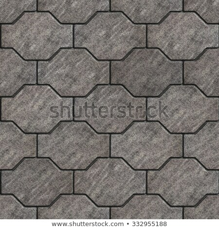Gray Scuffed Wavy Paving Slabs. Stock photo © tashatuvango