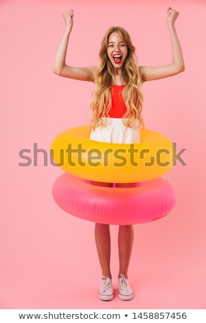 Seductive charming young woman with long curly hair in swimsuit  Stock photo © deandrobot