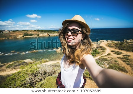 Beautiful young smiling woman at overlook Stock photo © dash