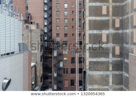 Fogo escapar escada velho tijolo arranha-céu Foto stock © meinzahn