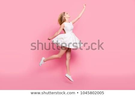 Jumping tenero ragazza rosa capelli isolato Foto d'archivio © LightFieldStudios