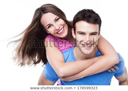 Fiatal vonzó pár élvezi háton nevet Stock fotó © deandrobot