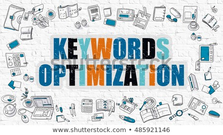 Keywords Optimization Drawn on White Brick Wall.  Stock photo © tashatuvango