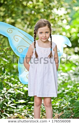 girl with pigtails in woods stock photo © is2