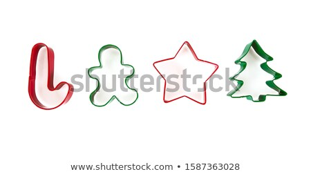 Gingerbread man and cookie cutter Stock photo © IS2