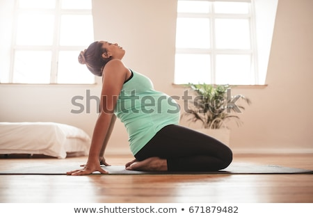 Pregnant women practising yoga Stock photo © IS2