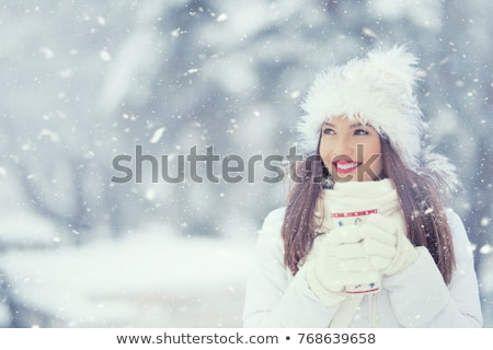 Portrait of girl with drink in snow Stock photo © IS2