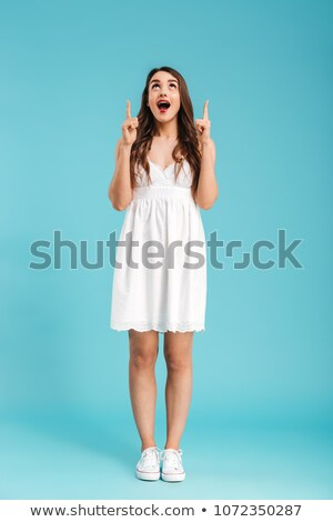 Full length of a beautiful woman looking up happy Stock photo © Giulio_Fornasar