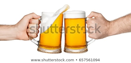 Man with a mug of beer foam Stock photo © rogistok